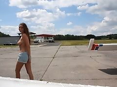 Buxomy Model Connie Carter Flashes Her Hooters In The Plane. Hd