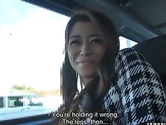 Japanese Chick Maki Hojo Gives A Good Deep Throat In The Car To One Horny Driver