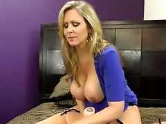 Huge-titted Mummy Julia Ann Jacks Him Off!